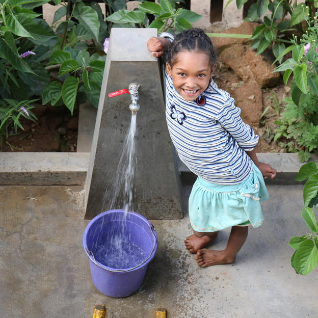 """Having running water in the village is so nice; we are cleaner."" Salohy, 12 years old, fetching water at one of the six water points in Antsesika village, Ambohiborona commune, Faratsiho district, Vakinankaratra region, Madagascar. February 2017."