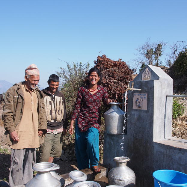 Chet Kumari Basnet filling water at the tapstand nearby her home. From left Ichha Bd. Basnet, 70, Mekh Bd. Basnet, 35 and Chet Kumari Basnet, 29. Hardeni VDC, Udayapur, Nepal, Mar 2014