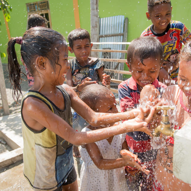Children celebrate having water. Timor-Leste. 2017