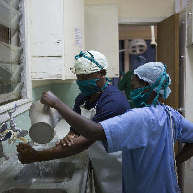 Doctors prepare to do a ceasarian section on Christina Emmanuel, 18, after her labour was progressing too slowly, at Kiomboi Hospital, Iramba, Tanzania, June 2015.