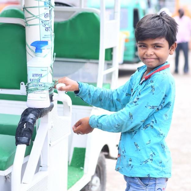 WaterAid India's 'WASH on Wheels', a handwashing station in a rickshaw campaign running in different districts of Uttar Pradesh, India. Covid-19 response. July 2020