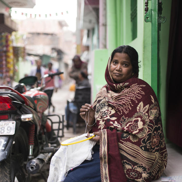 Zarina Begum does Chikankari embroidery work outside her house in the Bharat puri slum settlement. Like many others living in her community, Zarina is a daily wage labourer, and therefore misses out on work when she falls sick. Zarina is paid approxim ...