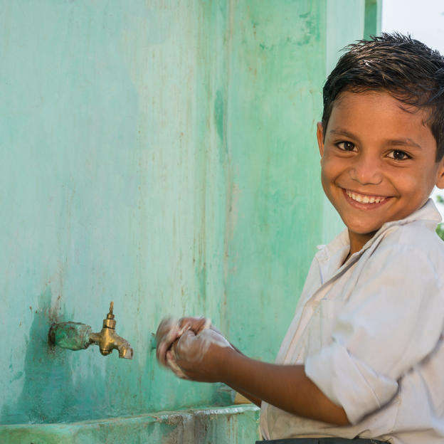 Student washing hands in Tharparkar