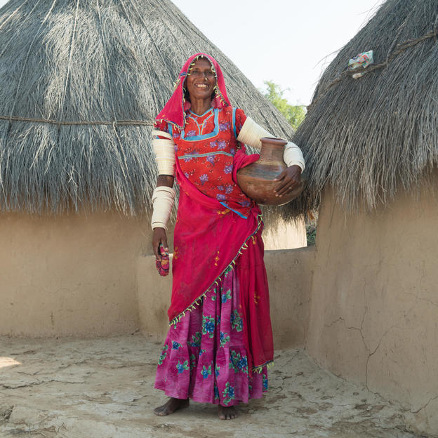 Banno, 48, holding a 'kooza', a local water container made from mud, in front of her house in the village of Bhanani Bheel, Union Council Joruo, Taluka Mithi, District Tharparkar, Province Sindh, Pakistan, August 2017