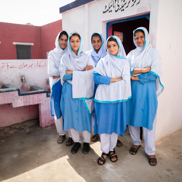 WASH group members, (left to right) Kiran, Mahwish, Saba, Ramsha and Iqra, in front of the WaterAid installed girls' friendly toilet in Government Girls High School, District Muzaffargarh, Province Punjab, Pakistan. Credit: WaterAid/ Sibtain Haider