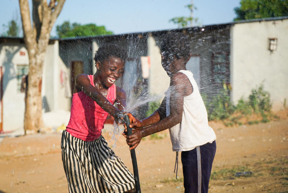 Cholera survivor, Mirriam, plays with her sister Avelina, 8. The family are happy to have clean water near their home. The pipes were installed after the cholera outbreak that has claimed many lives across the Chipata sub-district, Lusaka, Zambia, May ...