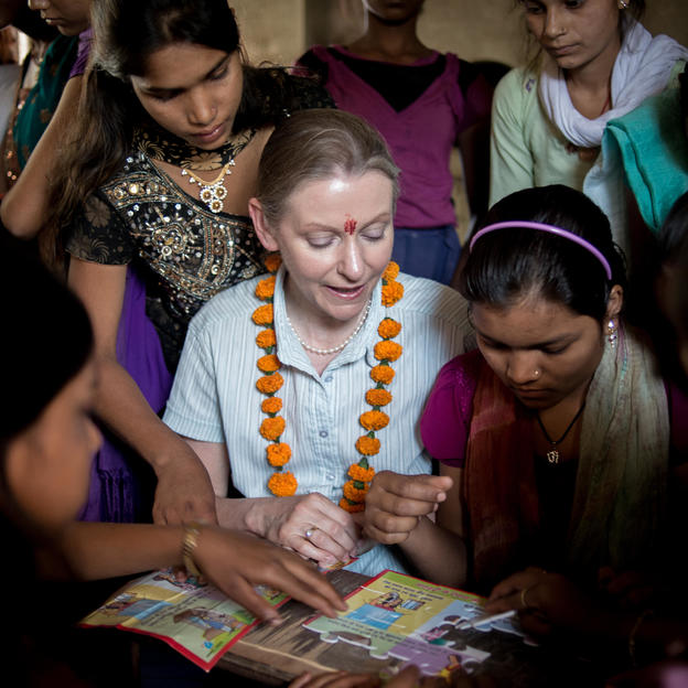 Sue Alexander from HSBC playing a game with students in Uttar Pradesh, India