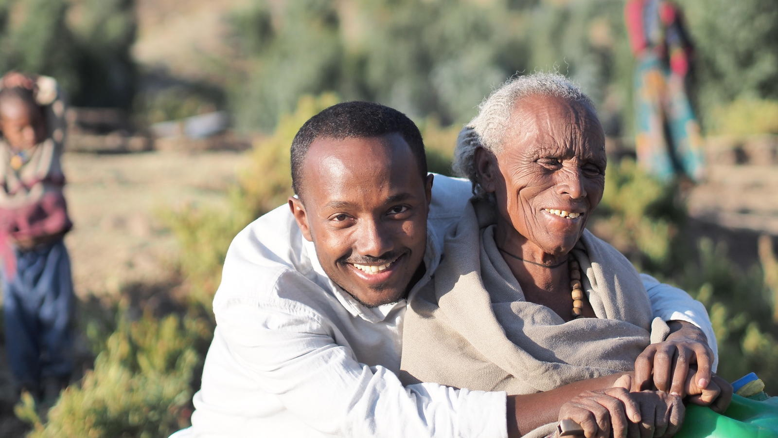 Behailu has his photo taken with 80-year-old Birhane in Tigray, Ethiopia.