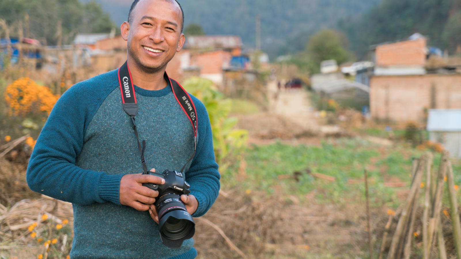 Our Voices from the Field Officer, Mani, with his camera in Lele, Nepal.