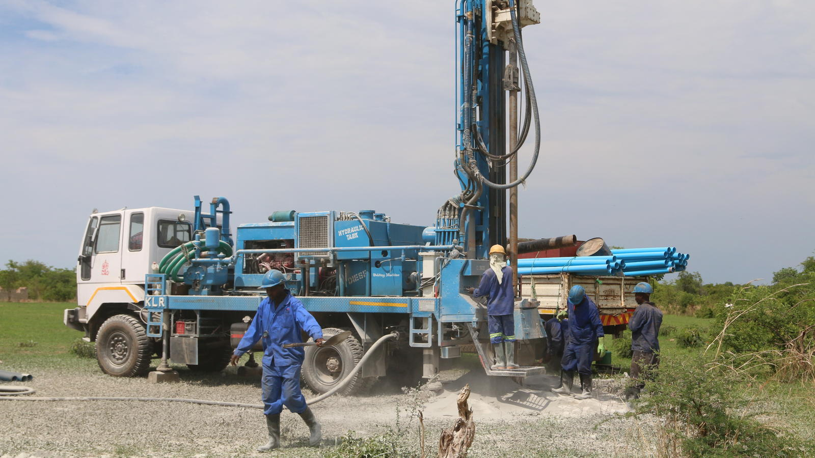 Men drill a borehole at a primary school in Zambia.