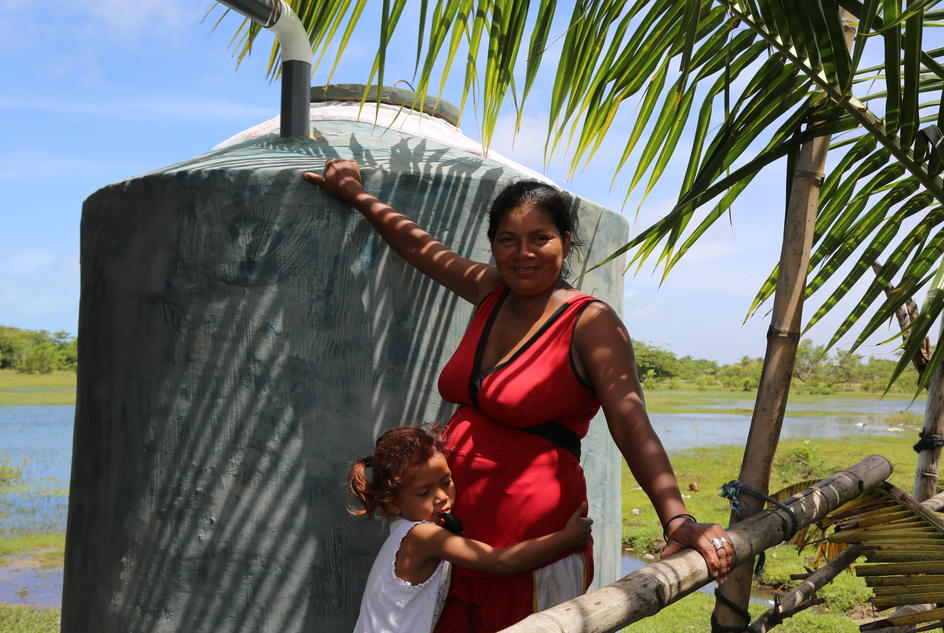 Carla and Caricia with their new rainwater harvesting tank in Wawa Bar, Nicaragua.