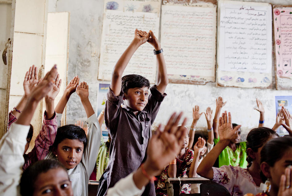 The students raise their hands in agreement that they will follow safe hygiene practices and use latrines at all times, Government Primary School (GPS) Harijan Colony Malan Hore Veena, Tharparkar, Pakistan, 2013.