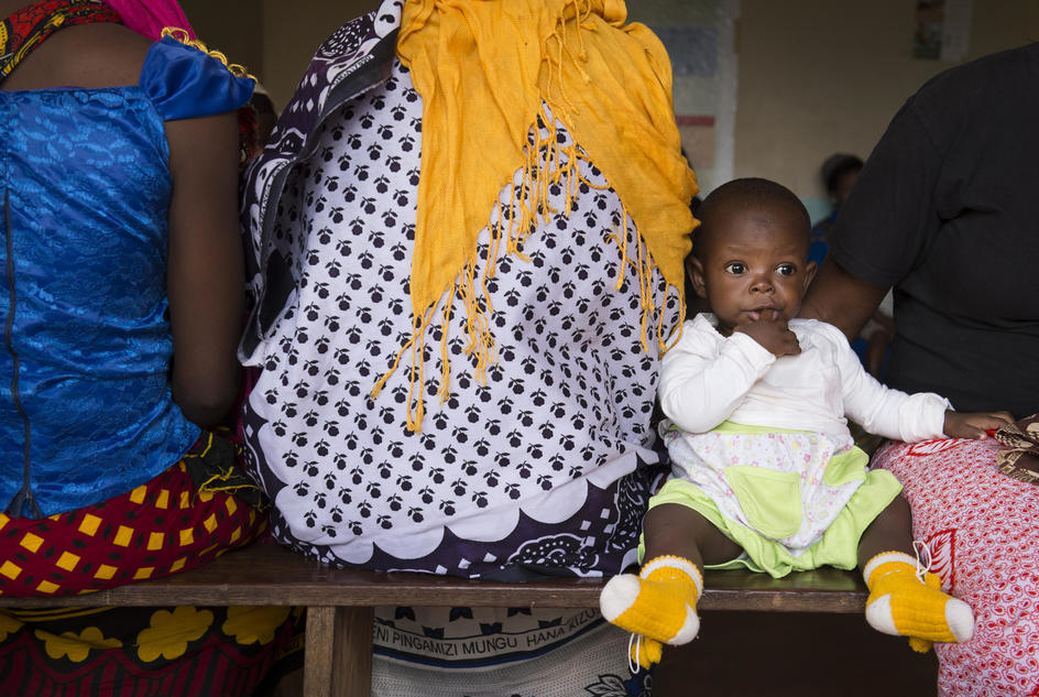 A young child sits on a bench at a post natal clinic at the Mlali Health Centre in Tanzania.