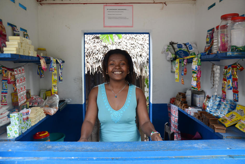 Elida stands at her water kiosk in Madagascar.
