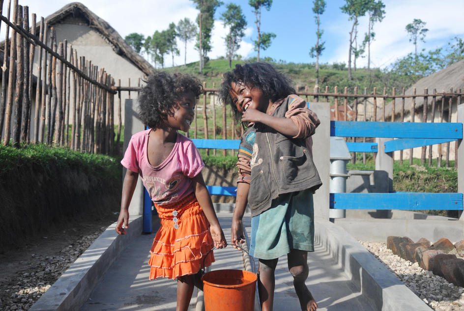 Volatiana with her sister, Solotiana, at one of the wells in their village in Madagascar.
