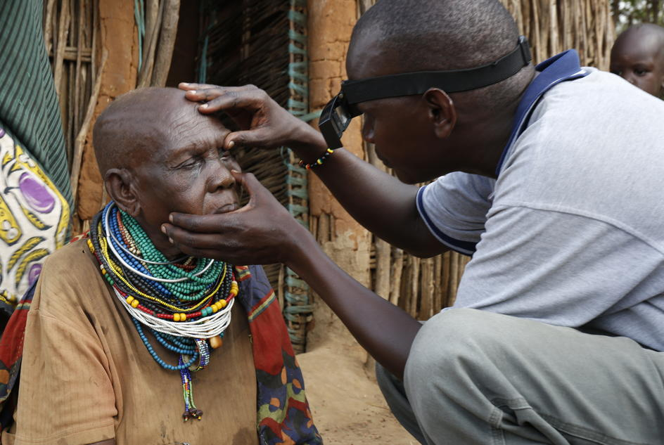 A medic inspects a patient suspected of suffering from trachoma.