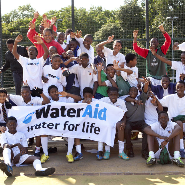 School students take part in football match to raise money for WaterAid, London, UK, 2013.