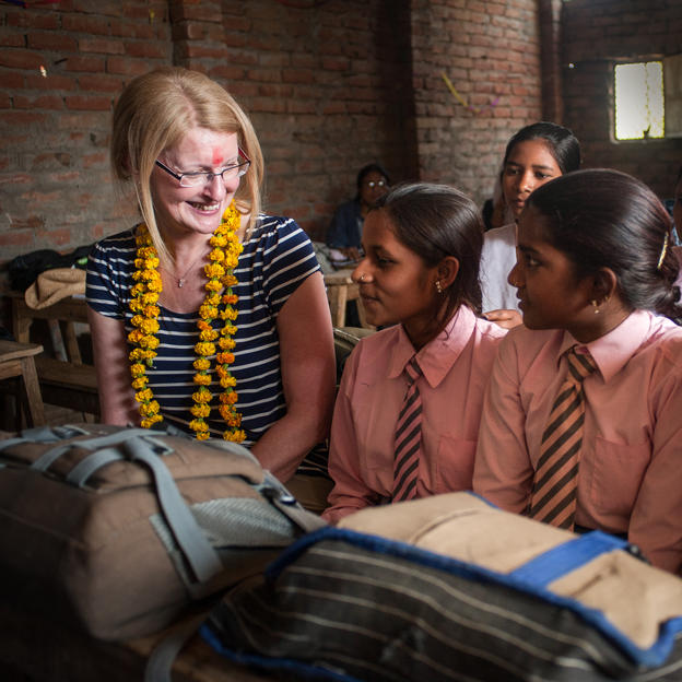 Janet Andrews with schoolgirls during a menstrual hygiene management session, Uttar Pradesh, India.