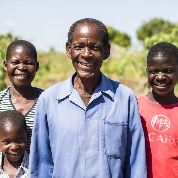 Paulino with his family in his village in Mozambique