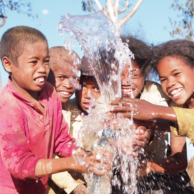 As the land is very hard to dig especially in the dry season, local community water it before digging to make it easier. An opportunity for children to drink safe water directly to the pipe.