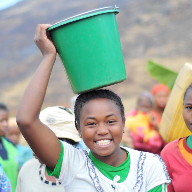 Tahiry celebrates the arrival of clean water in her village in Madagascar.