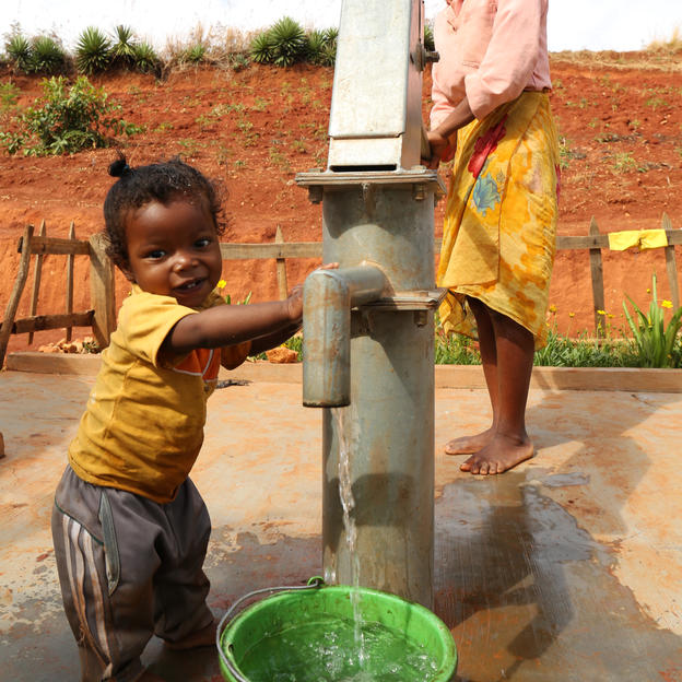 Angelo and his mother, Mariane, at their water point in Madagascar