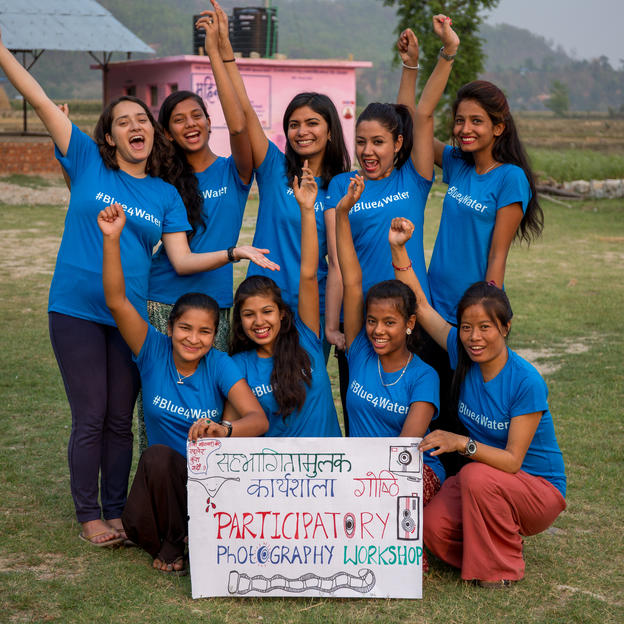 A group portrait of participants during a workshop in Nepal.