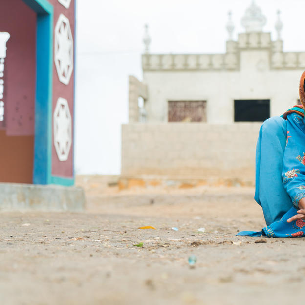 Ruqqa, 12, playing marbles in the village of Allah Sajan Khaskheli, Union Council Doomani Taluka, District Thatta, Province Sindh, Pakistan, July 2017