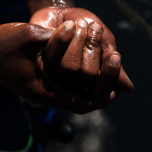 A team member cleaning his hands with disinfectant after an eThekwini Municipality sewage jetting crew cleared a blockage from a sewer line in Durban, in South Africa. March 2019.