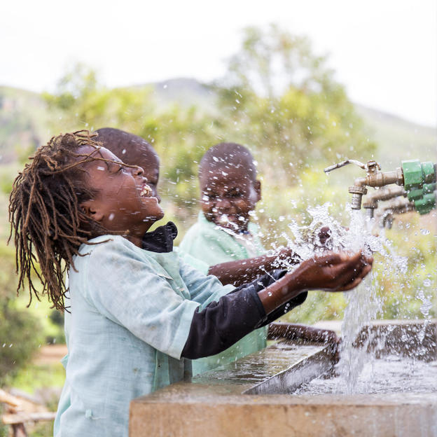 Toky, 7, and his friends washing their hands at the handwashing station of the sanitation block, Manantenasoa primary school, Fihaonana commune, Analamanga region, Madagascar, February 2019.