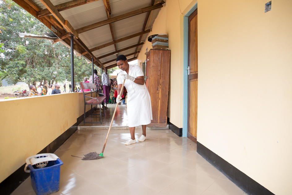 Nyaganga Juma Samuel, 37, nurse and midwife, cleaning her work area at Nyamalimbe Dispensary, Geita District, Tanzania, June, 2019.
