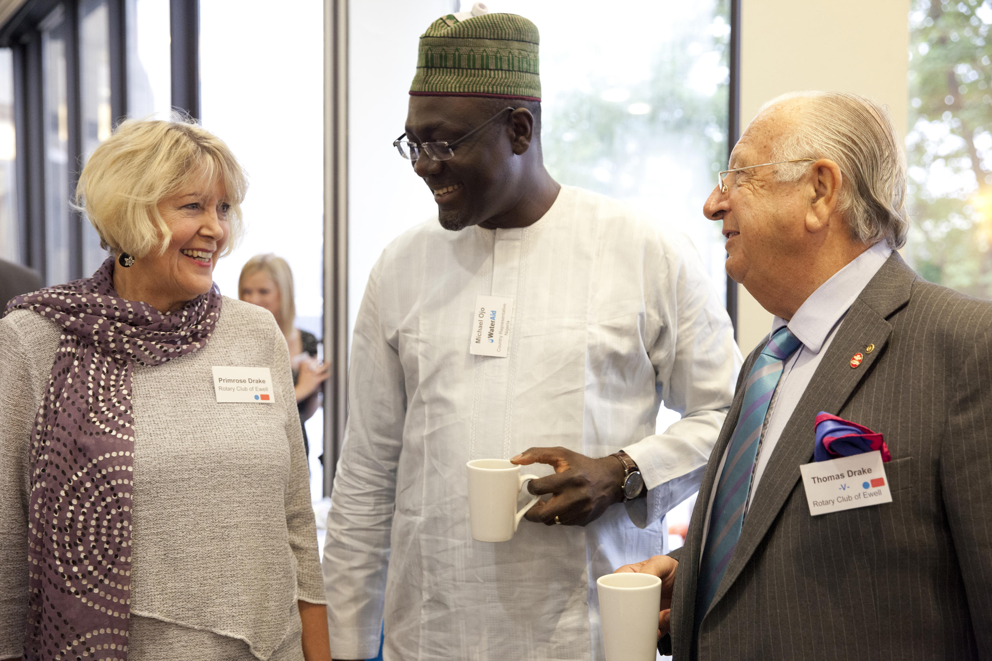 Supporters, Primrose Drake and Thomas Drake with Michael Ojo, (cenntre) Country Representative Nigeria, at the ASM, London, UK, 2013.