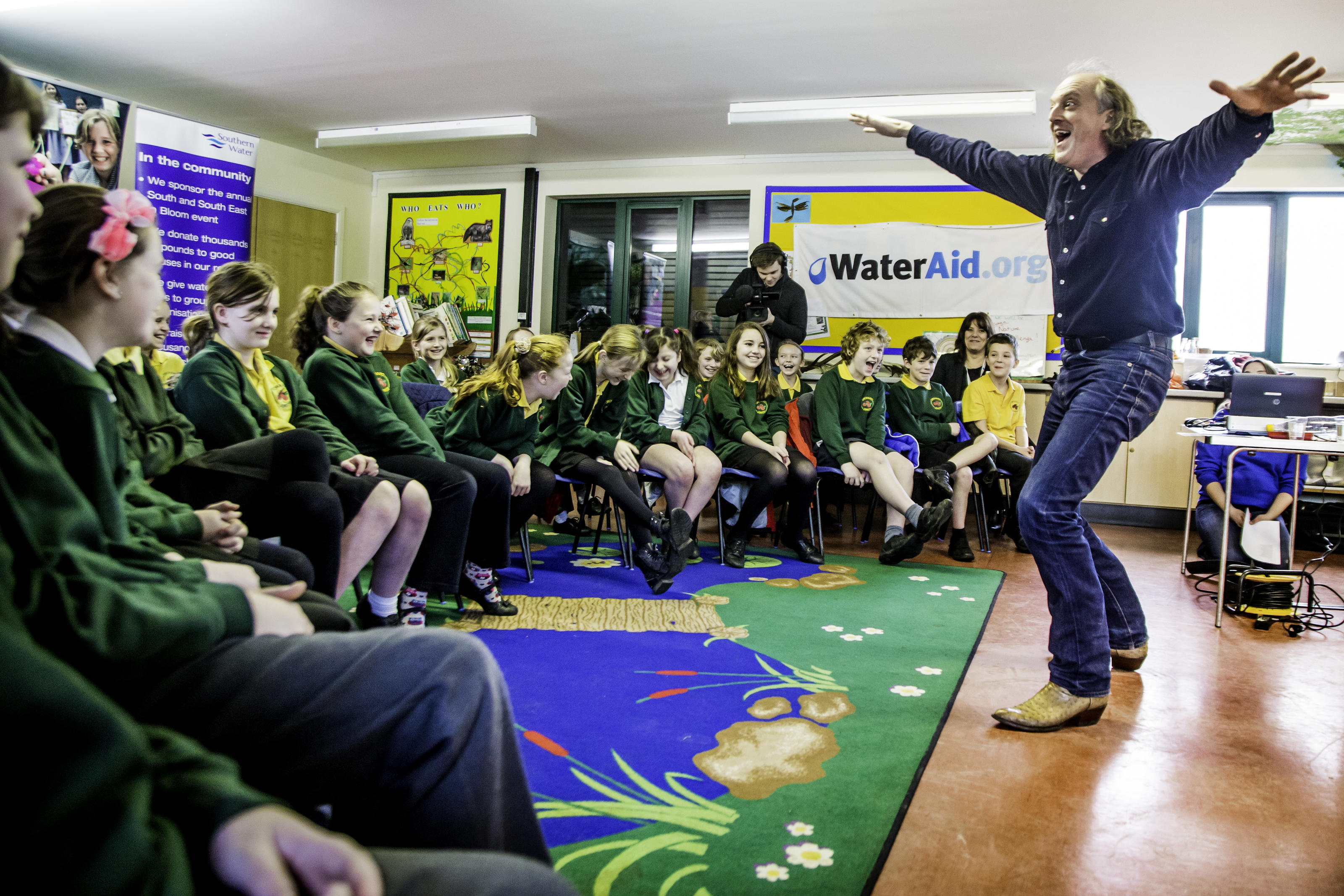 Children celebrate the launch of the WaterAid poetry competition.