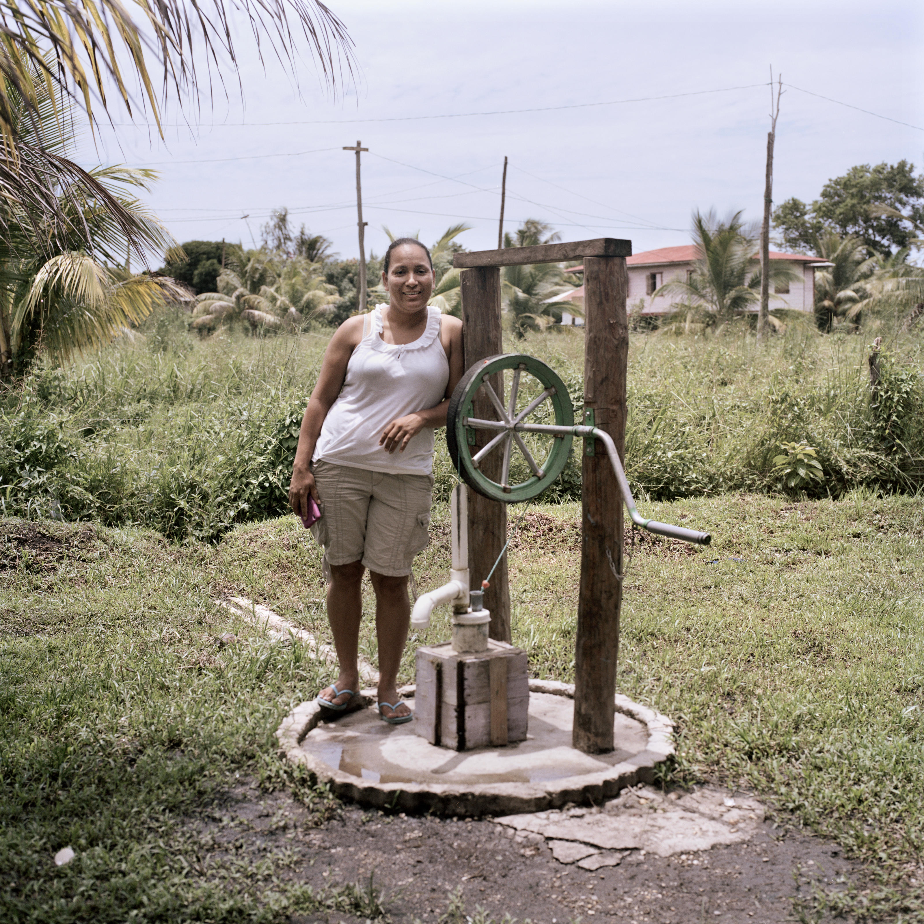 Suyen, pictured with a rope pump she bought through the scheme, in Bilwi, Nicaragua, August 2015.