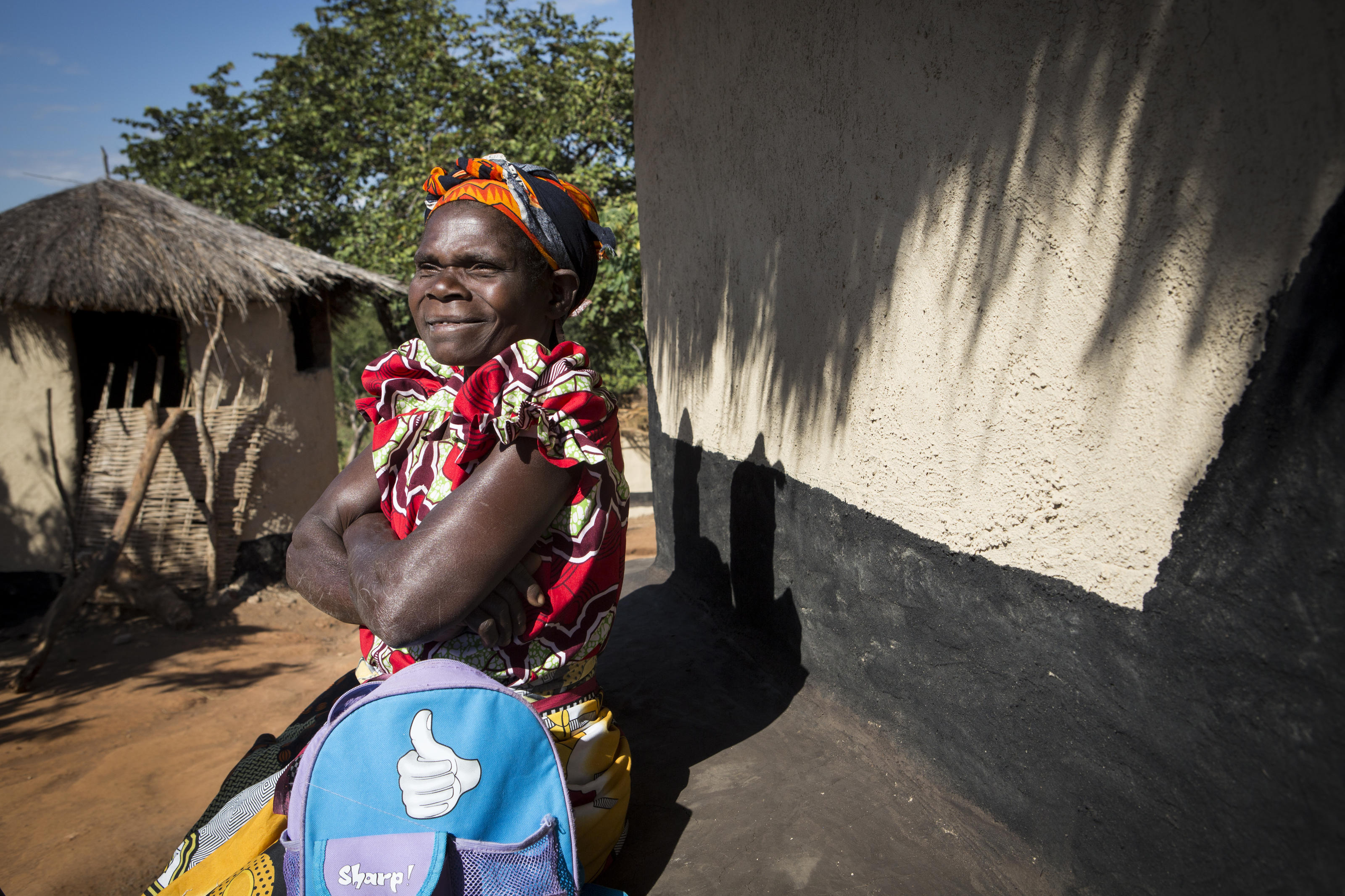 Kestina outside her home in the village of Chandaka, Malawi.