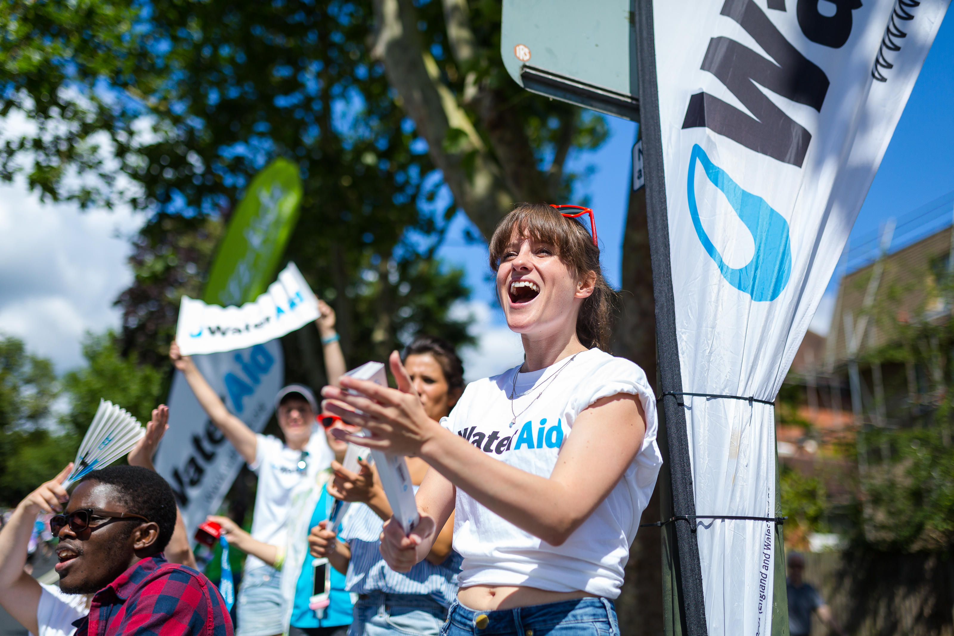 A WaterAid volunteer cheers at RideLondon-Surrey 100 2016.