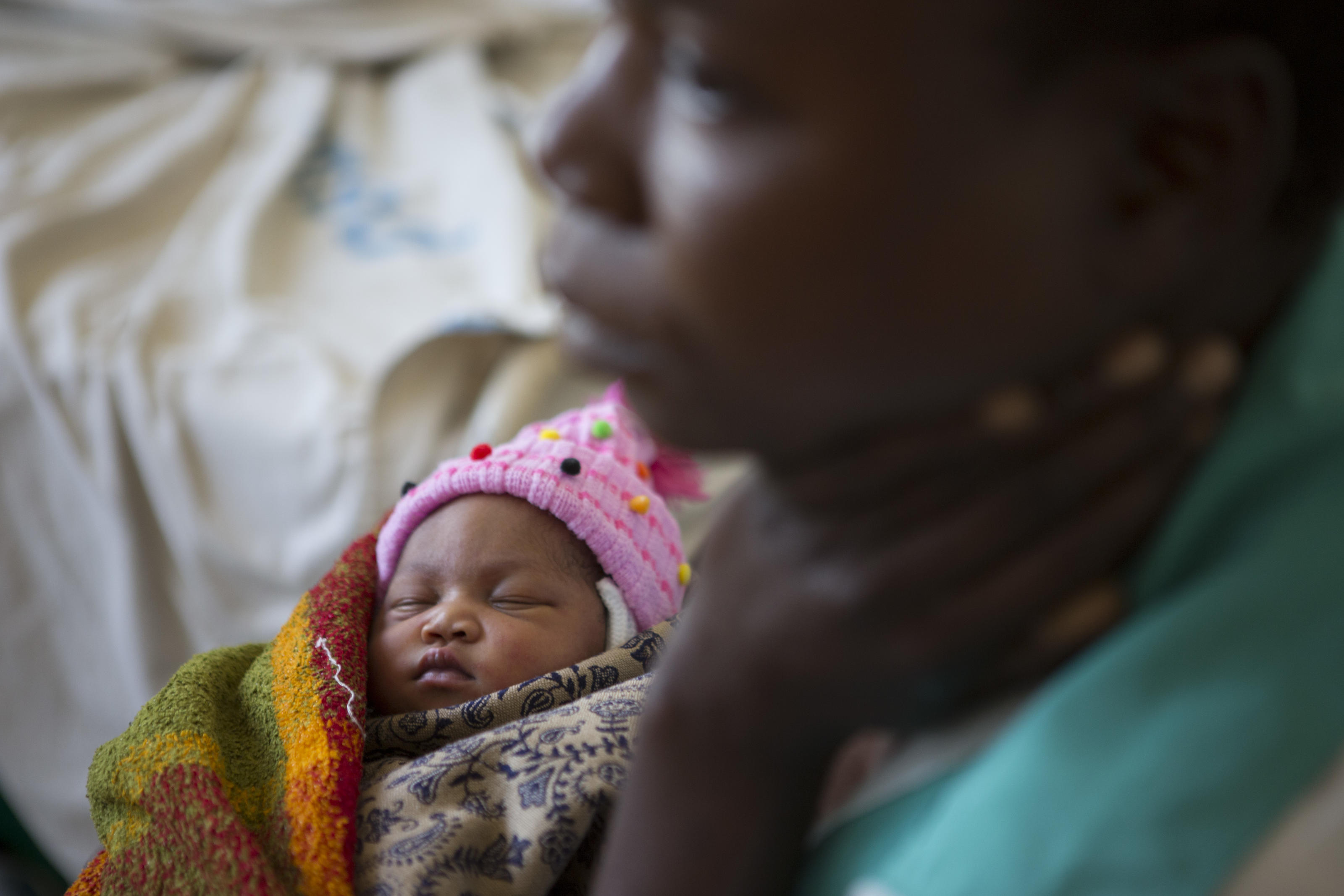 Zaituni holds her new born baby Mariam at Kiomboi Hospital, Tanzania, June 2015.