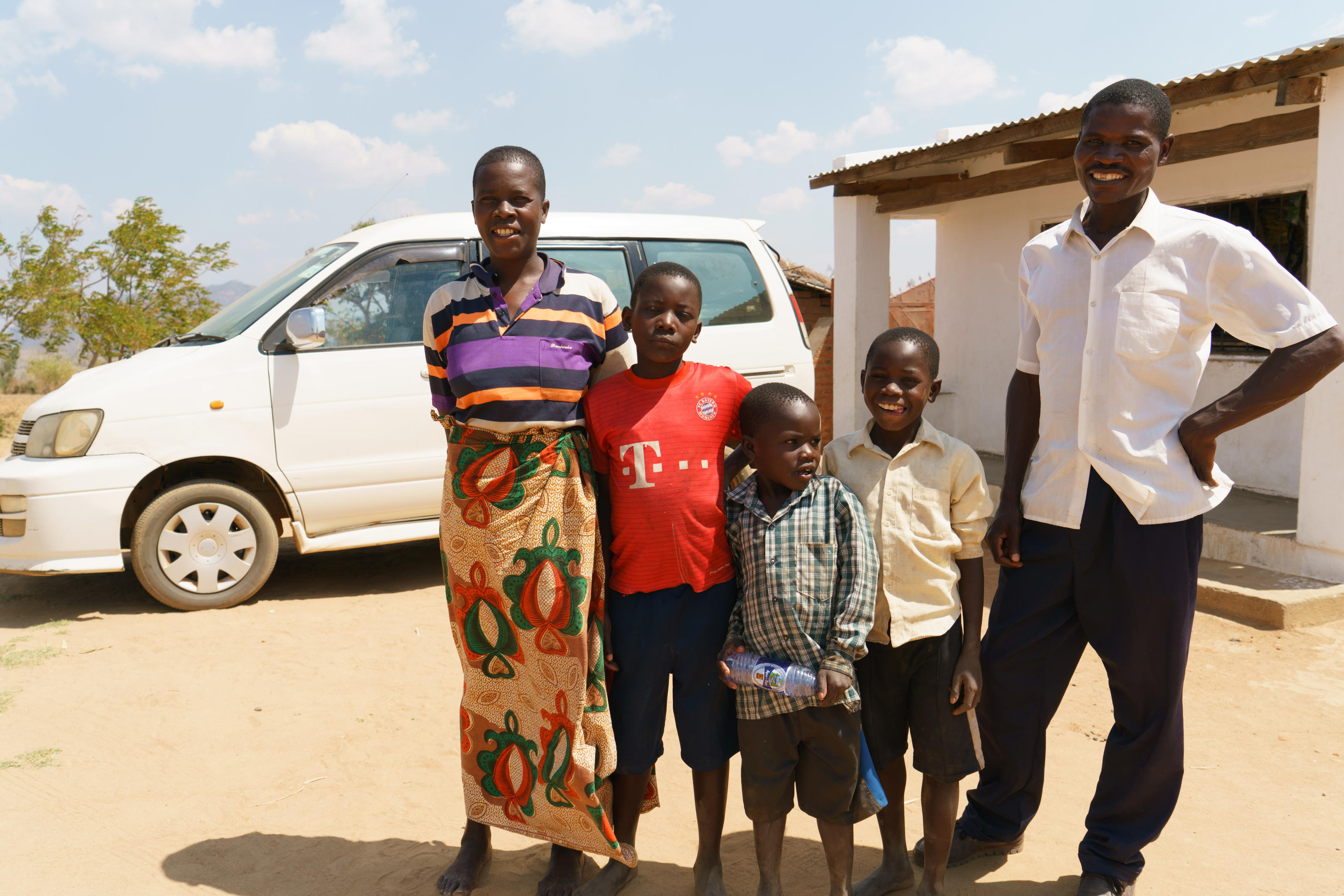 Joyce and her family in front of their new car in Vimphere, September 2017.