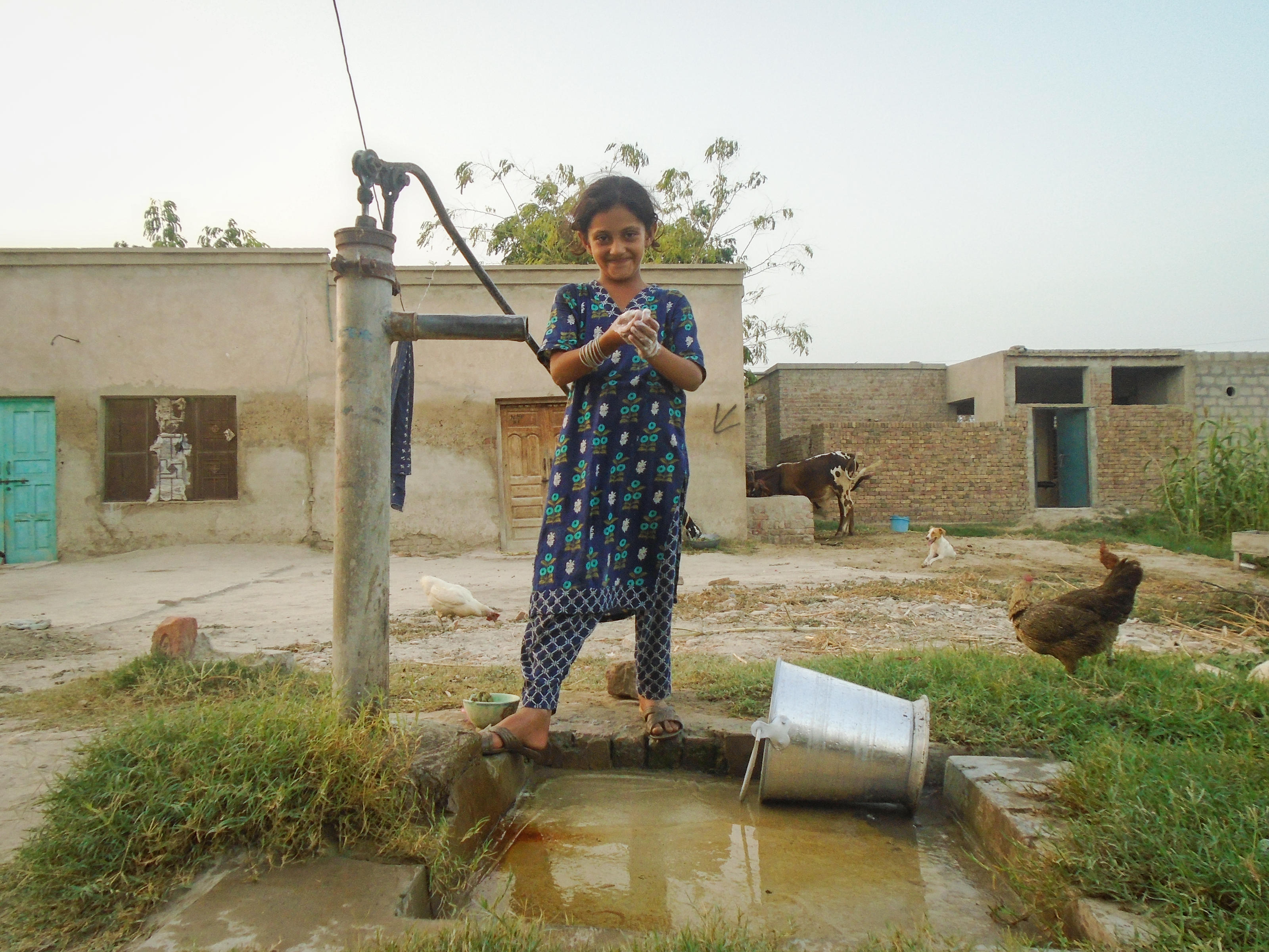 Ishqeen, 7, washing her hands with soap in Pakistan, August 2017.