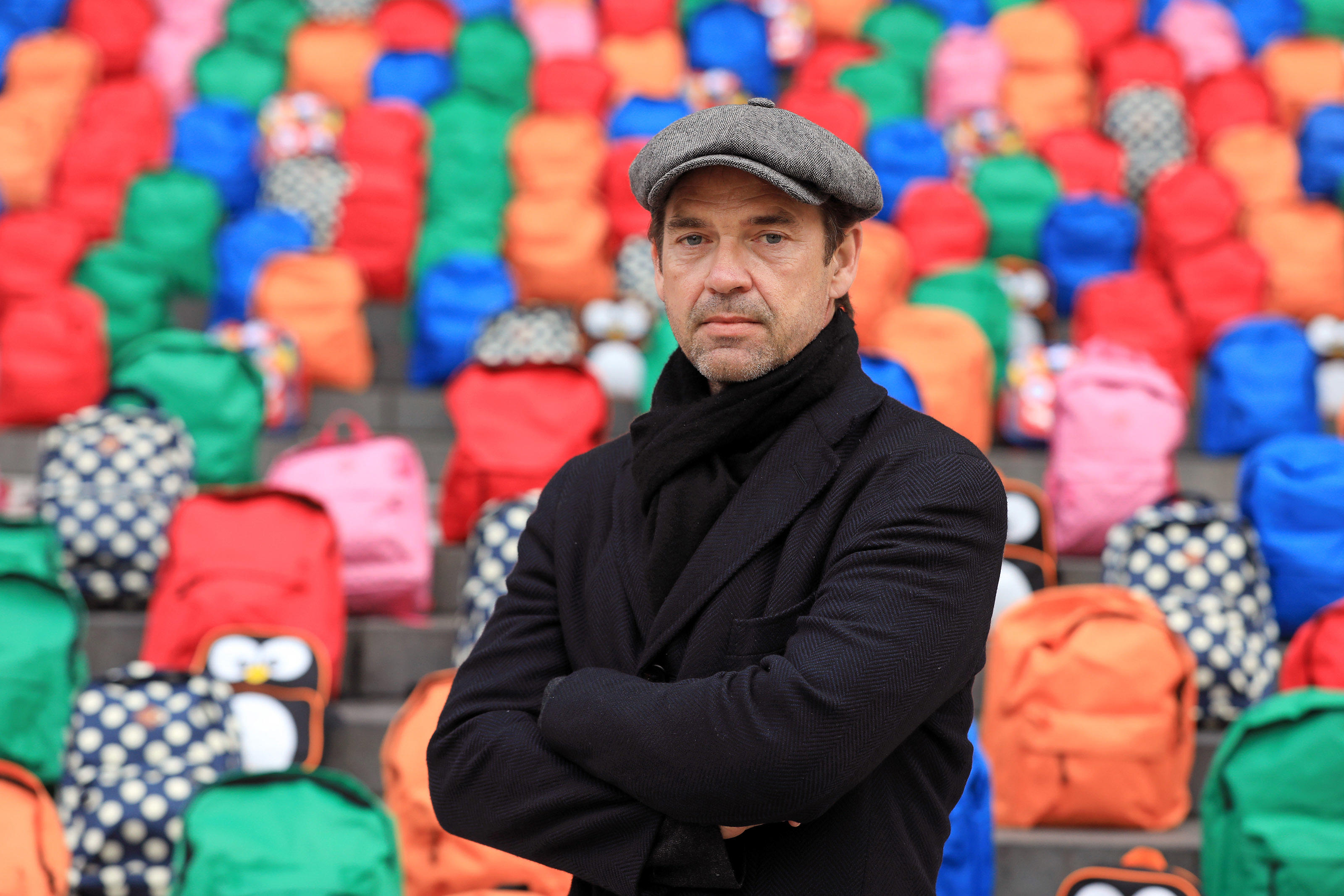 Actor and WaterAid Ambassador Dougray Scott looks at the 800 schoolbags laid by WaterAid on the steps of St Paul's Cathedral in a moving tribute to the number of children who die every day from dirty water, never reaching their fifth birthday or first ...