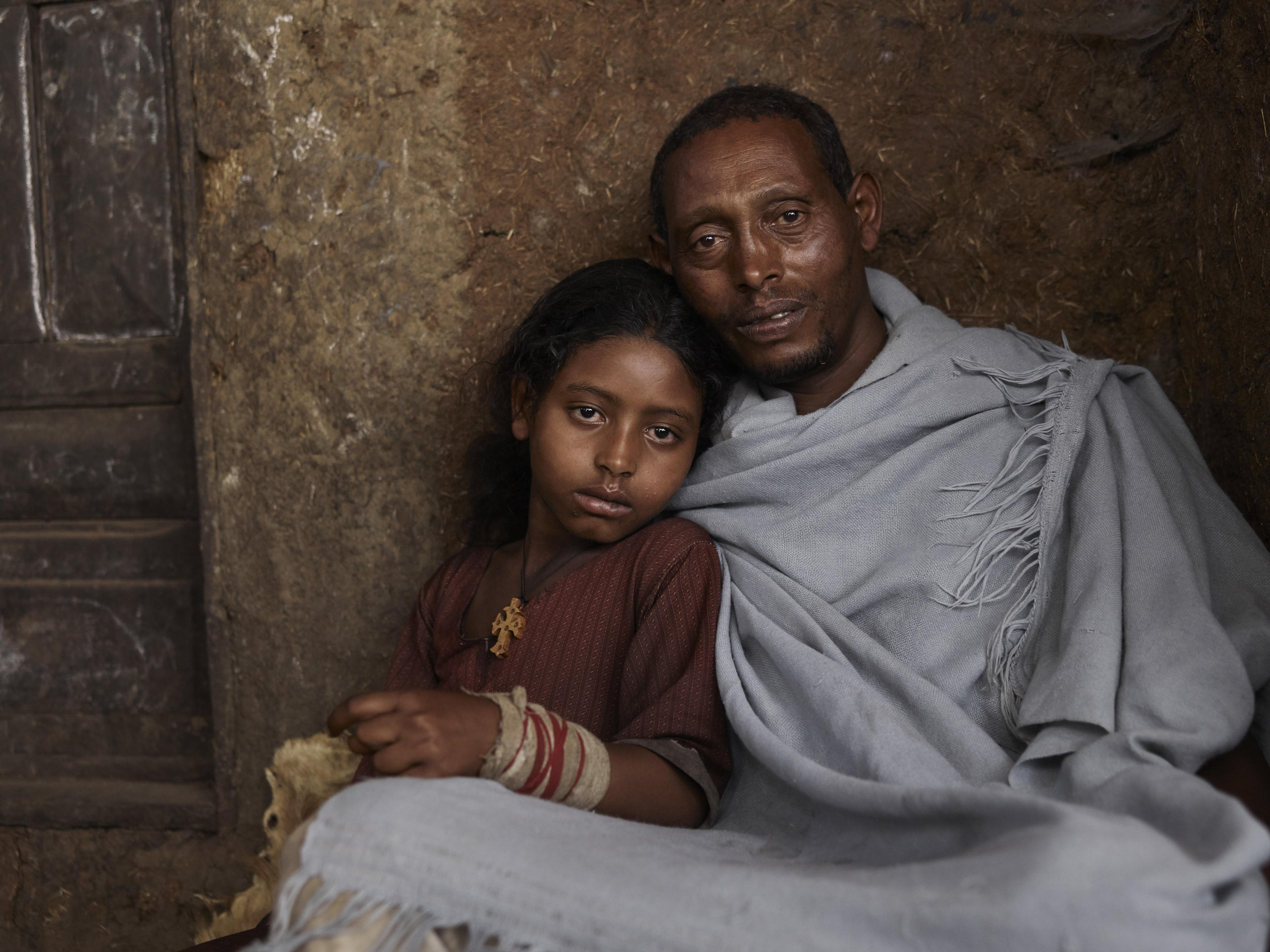 Animut with his daughter Aynadis in Frat, Ethiopia.