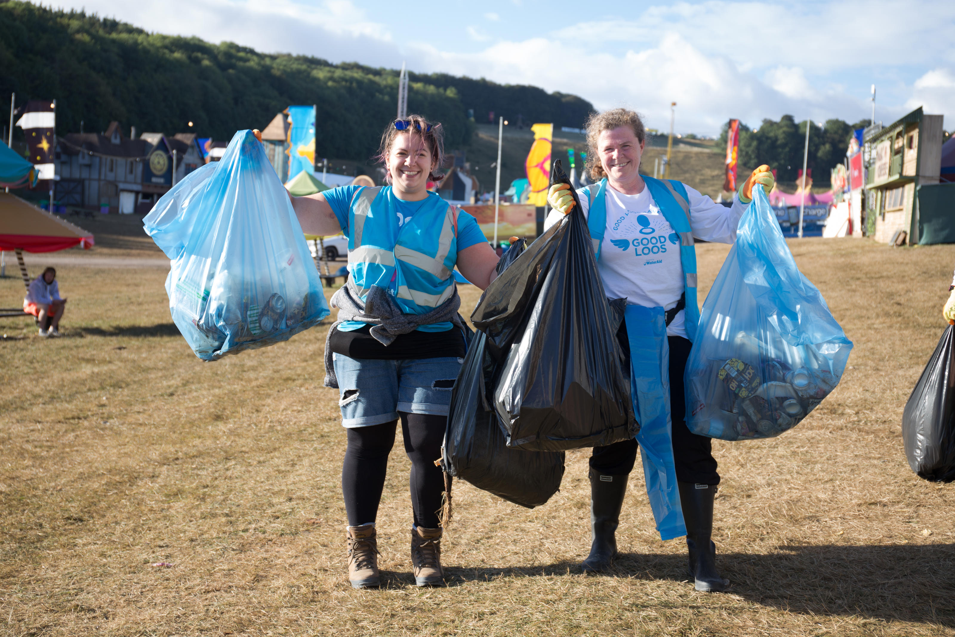WaterAid volunteers Emma and June litter picking at Boomtown festival