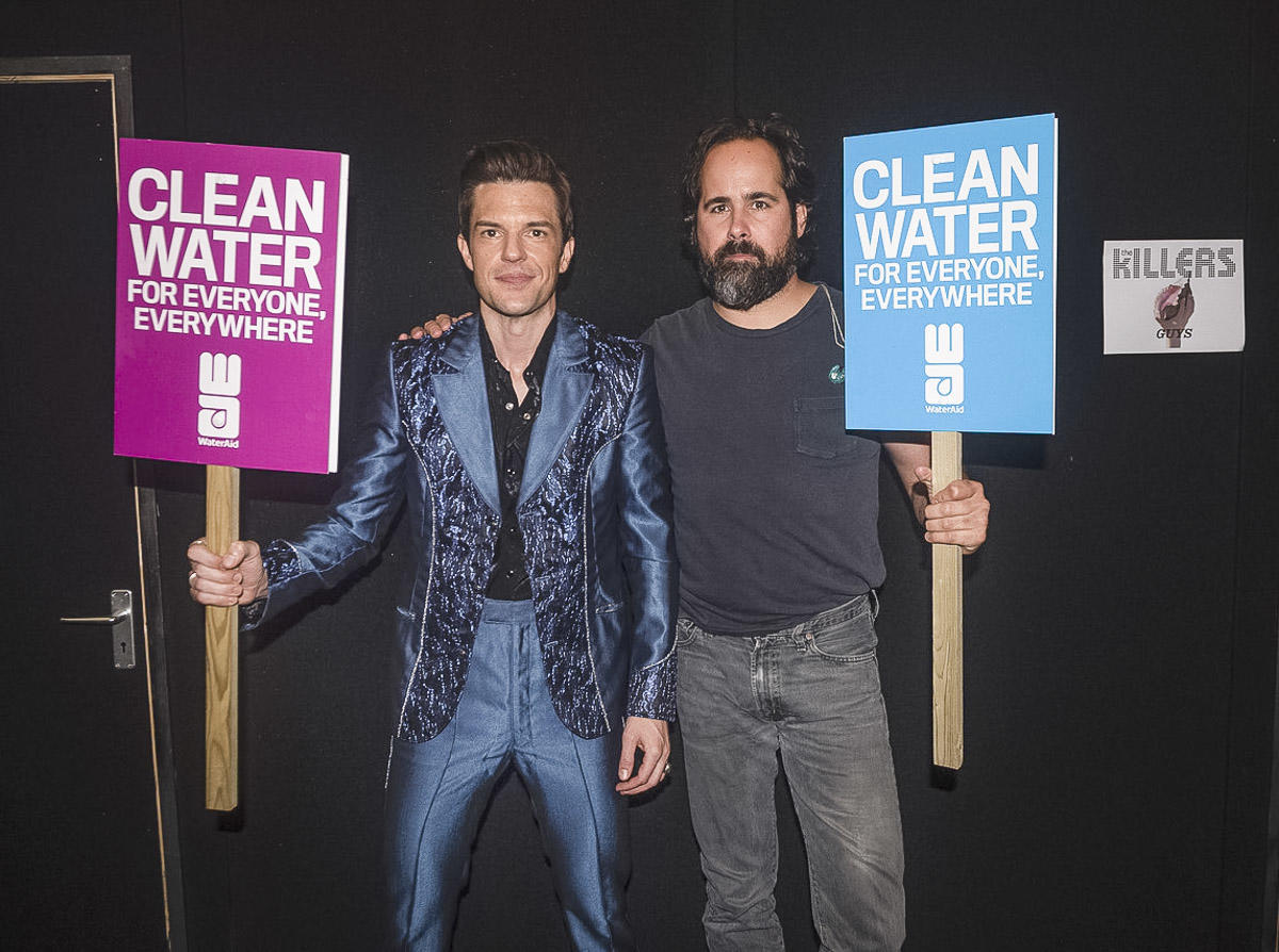 Brandon Flowers (L) and Ronnie Vannucci (R) of American rock band 'The Killers' supporting WaterAid's #accessdenied campaign at Glastonbury Festival, June 2019.