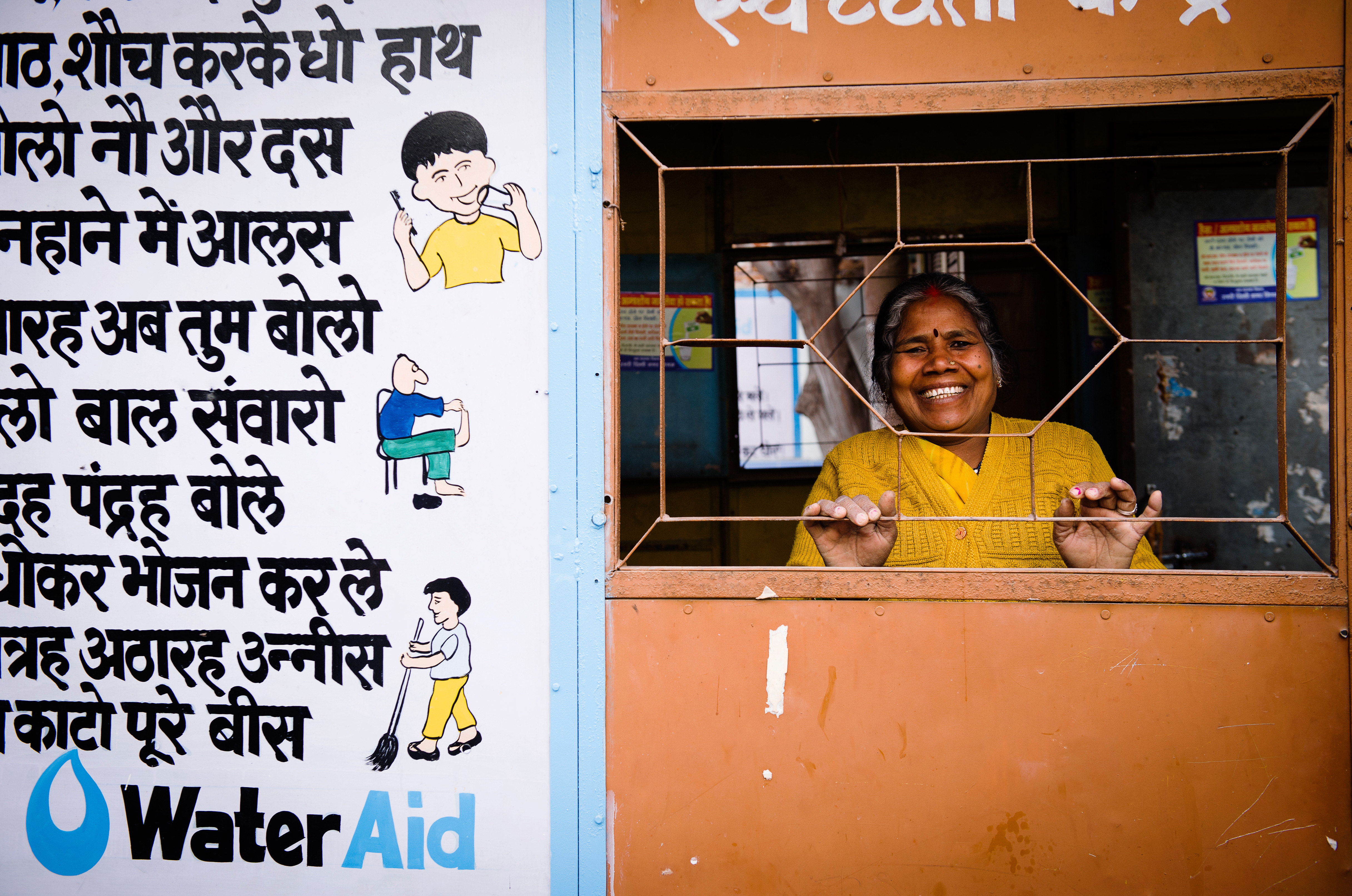 Chanda at her community's new toilet block in Delhi India.