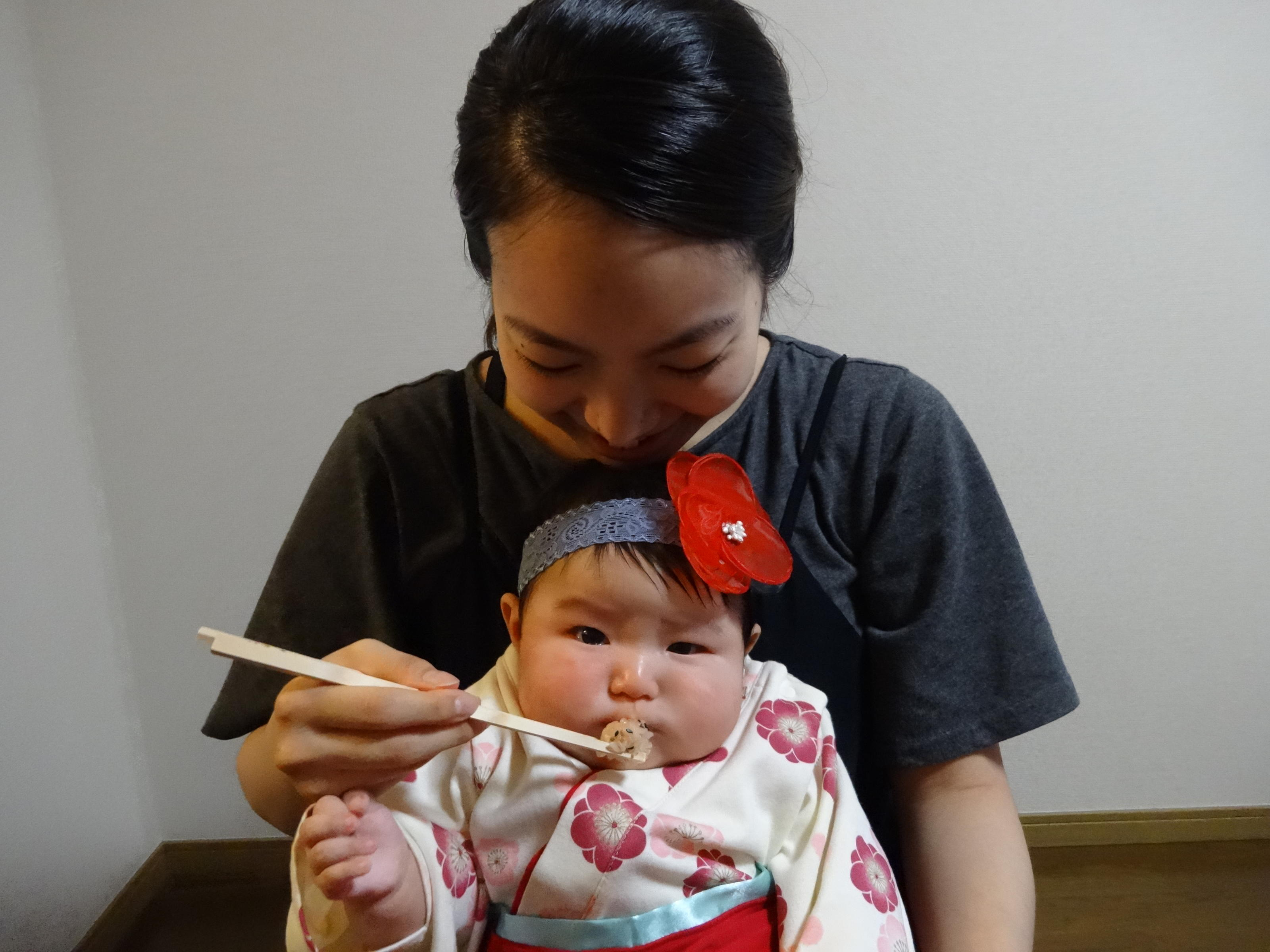 FIRST FOOD CEREMONY: In Japan, Natsumi, 29, feeds her daughter Miwa, four weeks old, during Okuizome, a first food ceremony