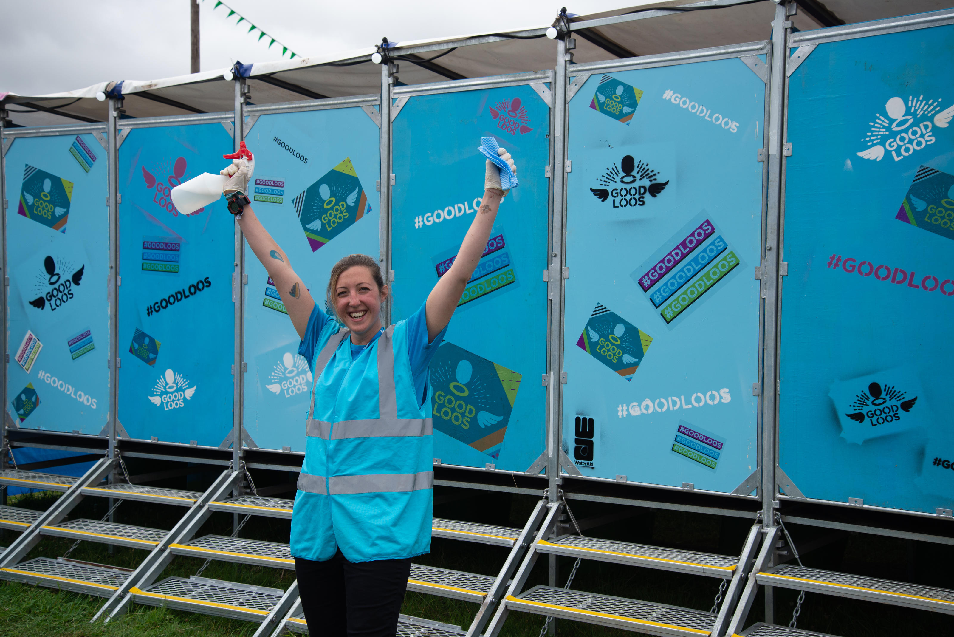 A volunteer at Latitude festival cleaning WaterAid's Good Loos