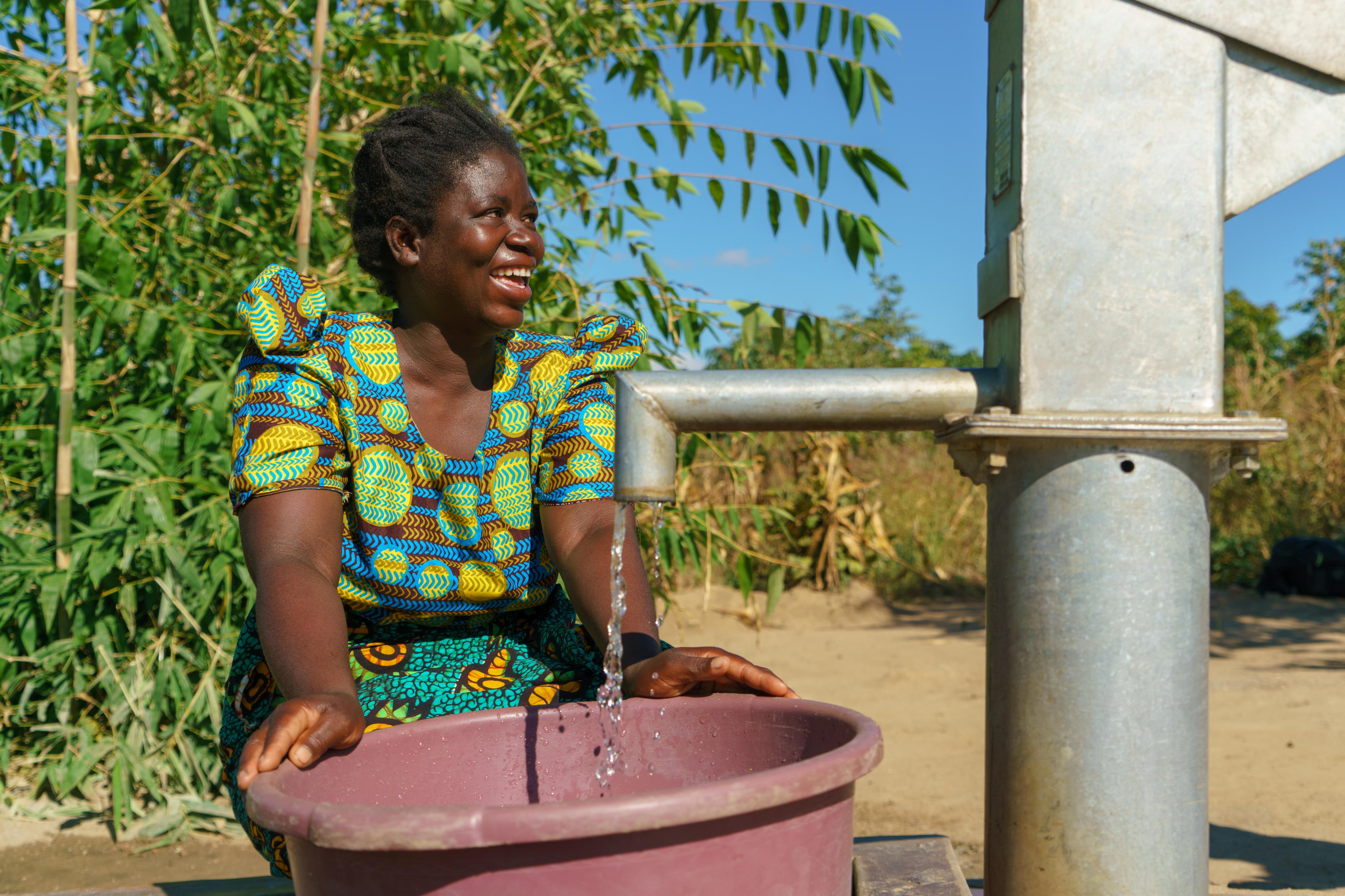 Ketilina drawing water from a borehole in Chilangiza village.