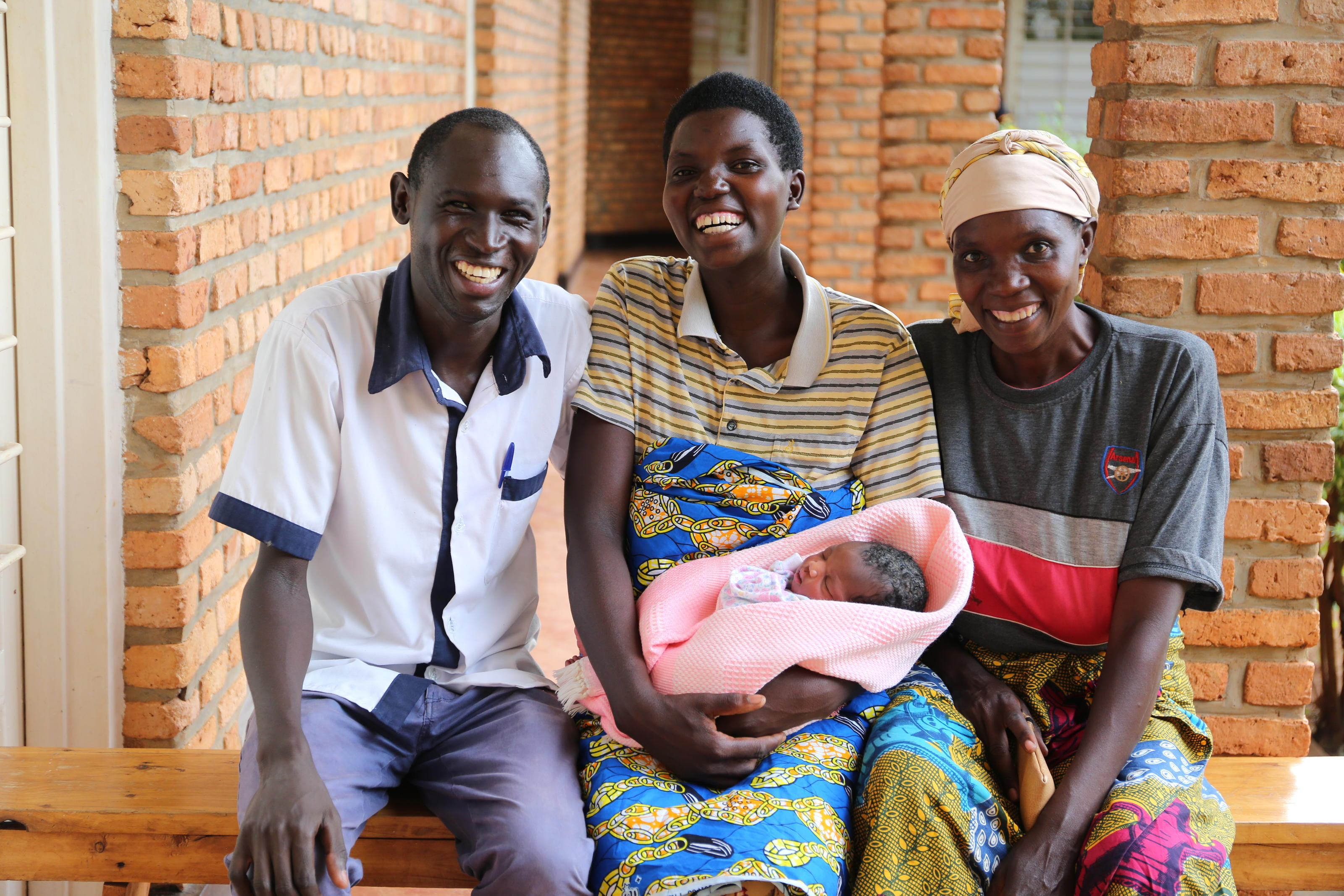 Nurse Samuel with Ruth and her baby and her mother at Nzangwa Health Centre, which was funded by WaterAid's Deliver Life campaign.