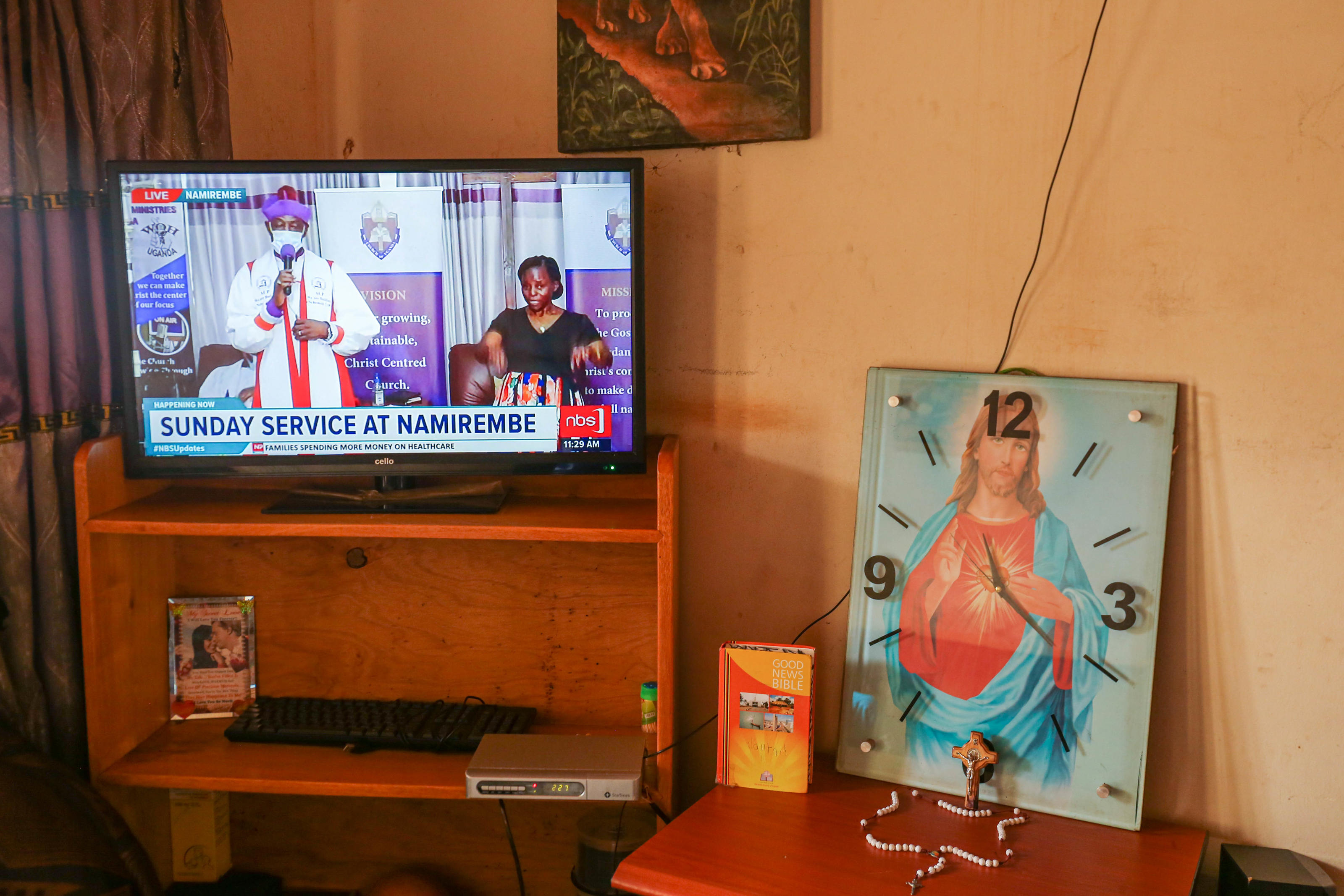 "Religious gatherings in Uganda have been suspended as a measure to curtail the spread of the coronavirus pandemic. Church services can only be followed on TV. ""Putting religious symbols near the TV gives me the feeling of the altar in our catholic chu ..."