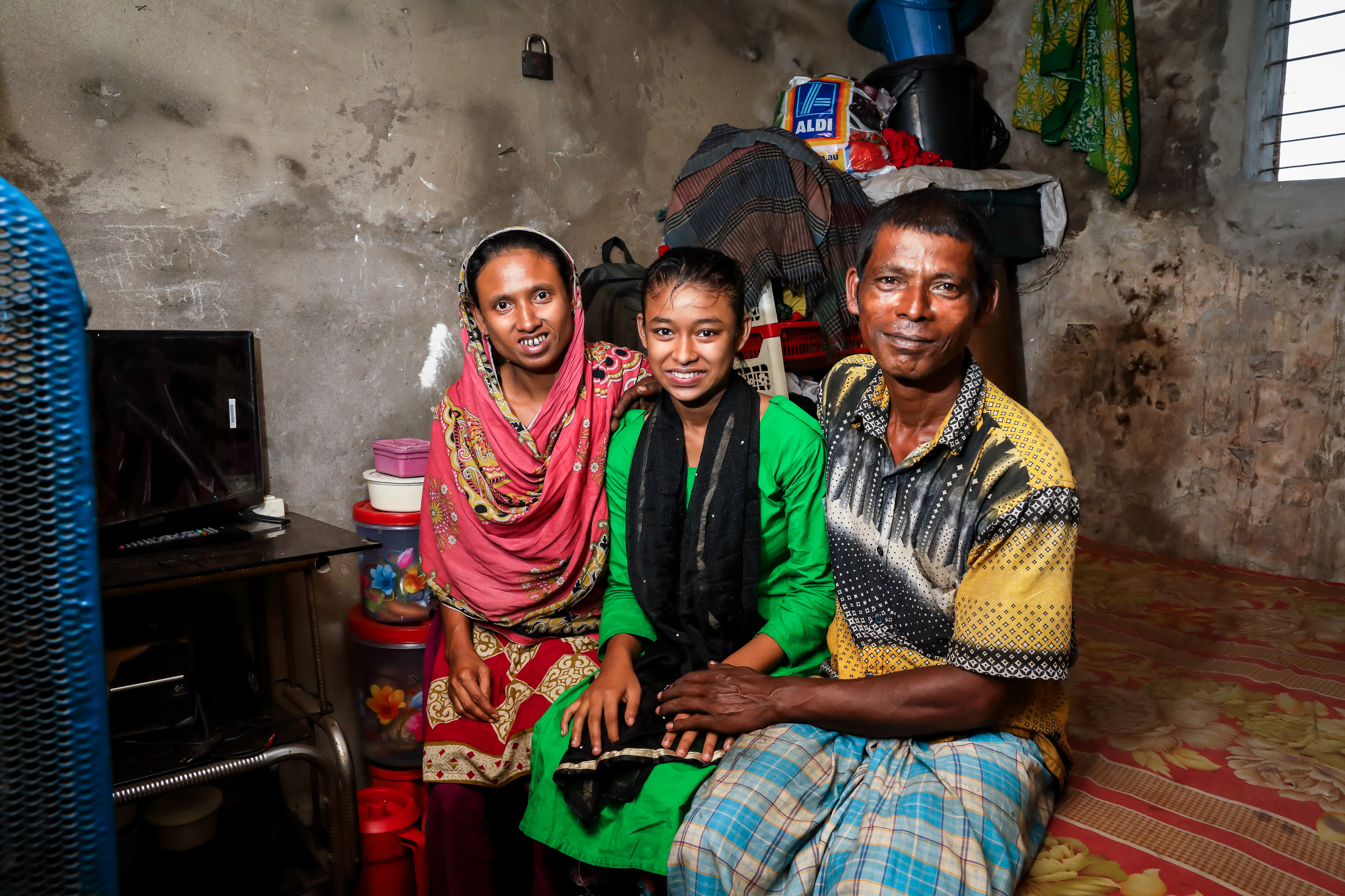 Sanjida with her mother Nazma and her father Abul in their home